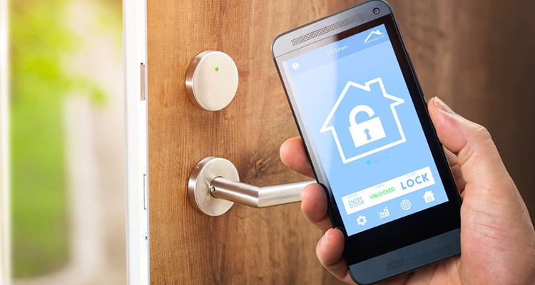 39552842 - smarthouse home automation device with app icons. man uses his smartphone with smart home security app to unlock the door of his house.